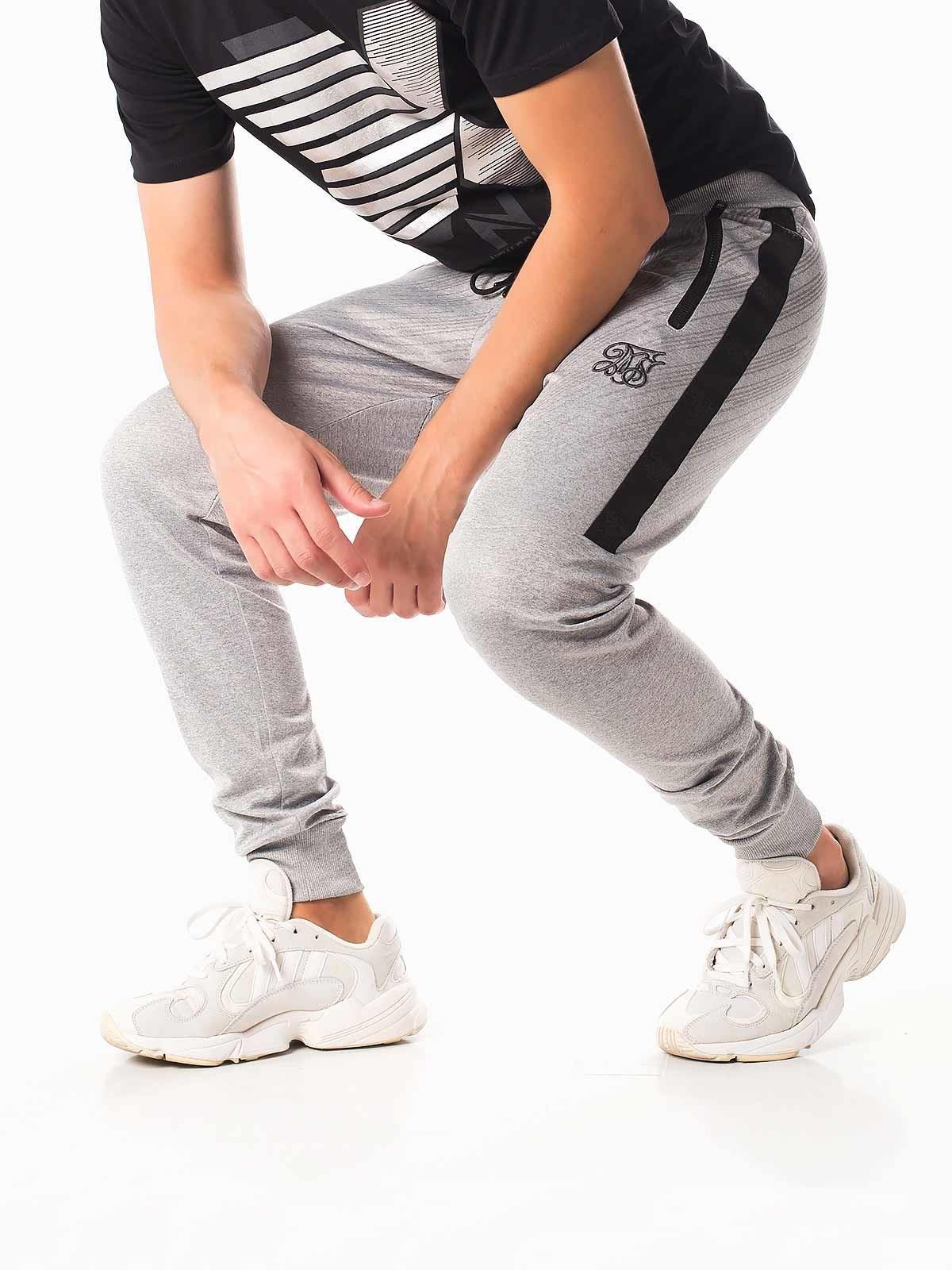 Pantalones de chándal ajustados bordado