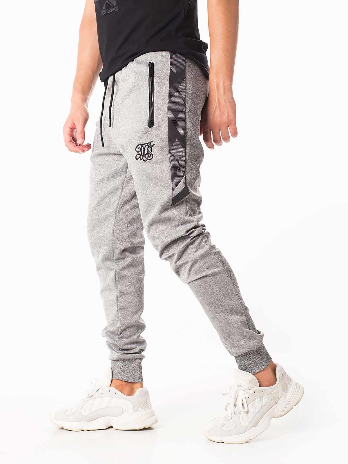 Pantalones chándal rayas estampadas